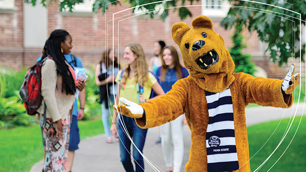 Nittany Lion standing with students