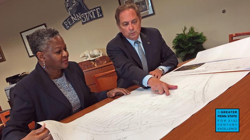 Dr. Richardson and Howard Kulp looking at blueprints