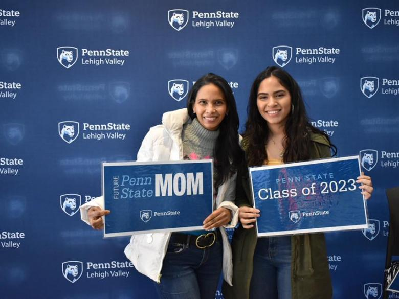 two women smiling in front of penn state lehigh valley logo backdrop