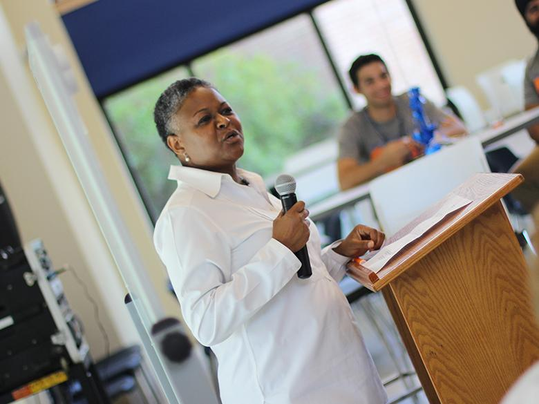 chancellor richardson speaking to an audience of faculty and staff with a microphone
