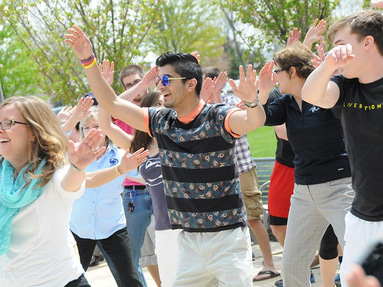 students dancing together in the penn state lehigh valley courtyard