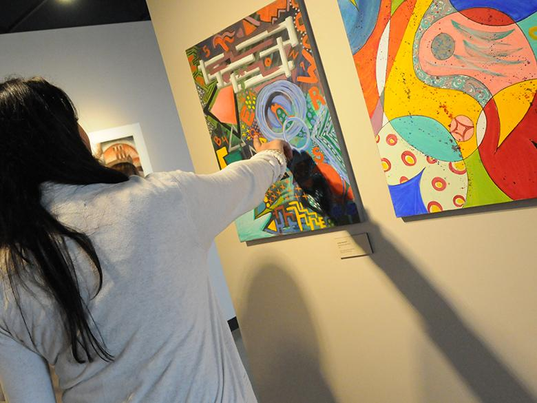 community members pointing at artwork that is part of the penn state lehigh valley collection