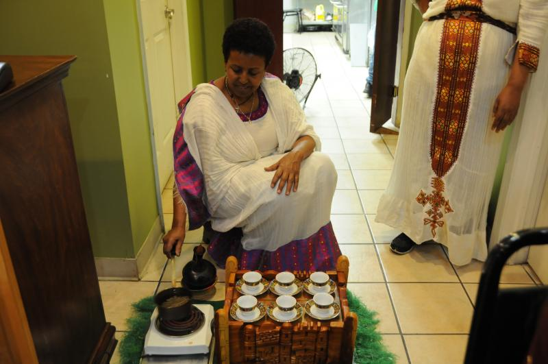 Woman making Ethiopian coffee