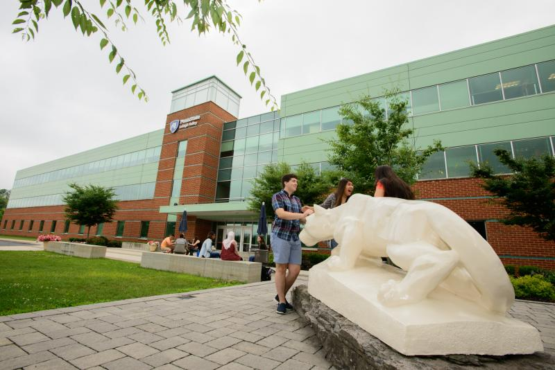 students by Lehigh Valley's Nittany Lion Shrine outside of building