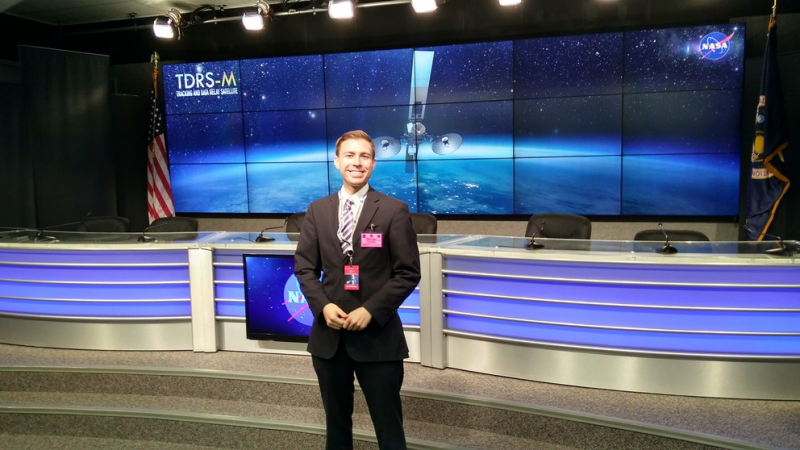man standing in front of screen at nasa