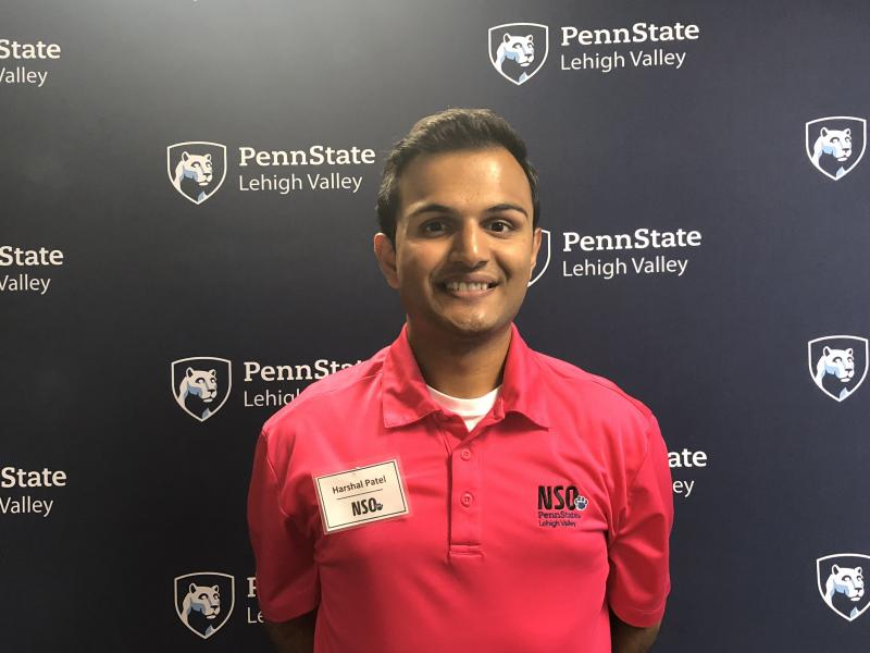 Young man standing in front of Penn State Lehigh Valley backdrop