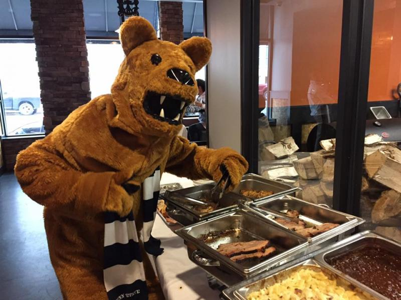Nittany Lion next to BBQ food