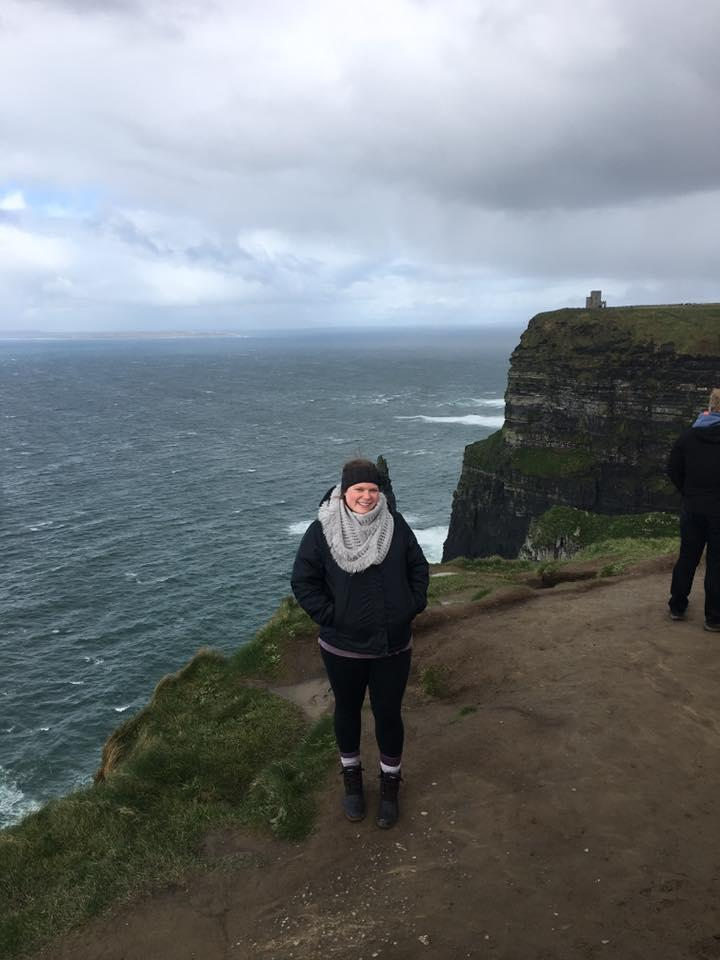 Student posing at Cliffs of Moher in Ireland