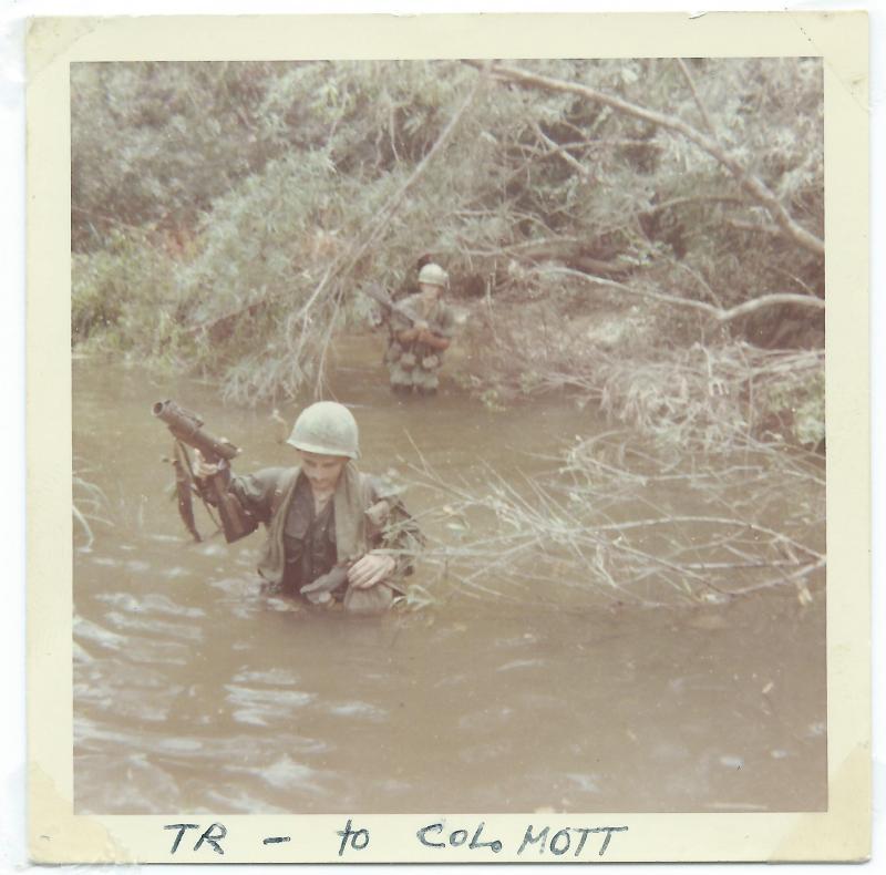 Tom Roney crossing a river in Vietnam