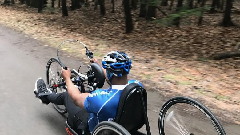 Athlete riding on a hand cycle bike