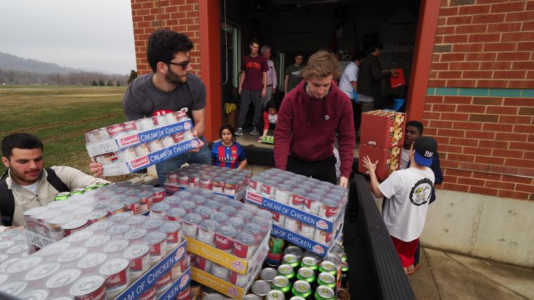 students unloading food donations off truck