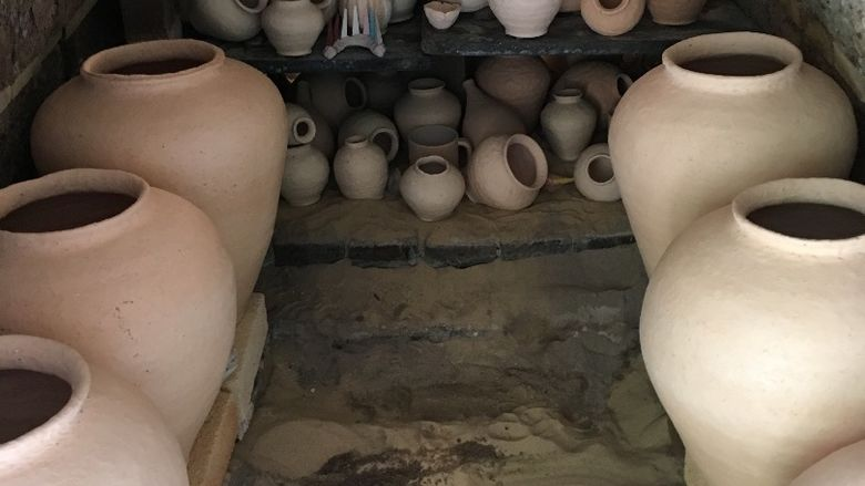 many pieces of pottery