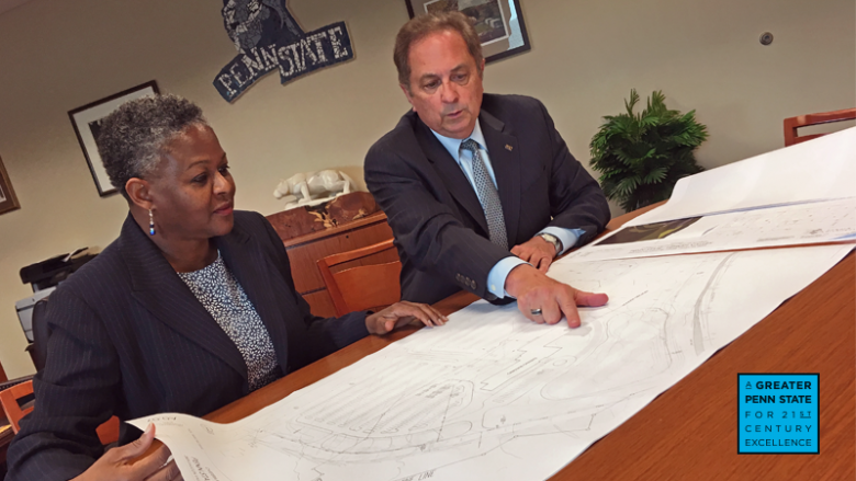 Dr. Richardson and Howard Kulp looking at blueprints