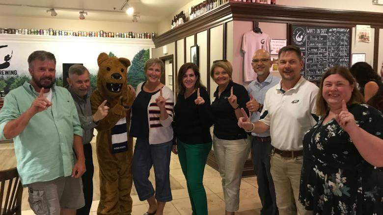 group of people with Nittany lion