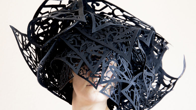artwork in shape of a hat made of laser cut fiber