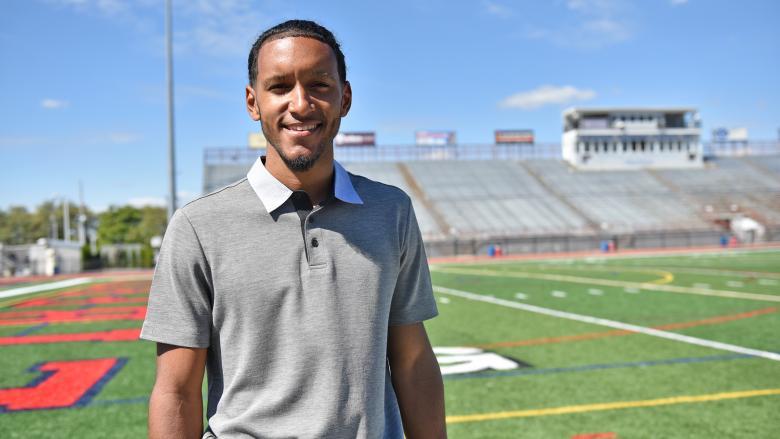 Jordan Young poses on the Liberty High School football field