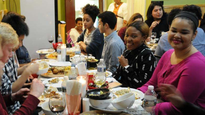 A group of students and alumni at dinner