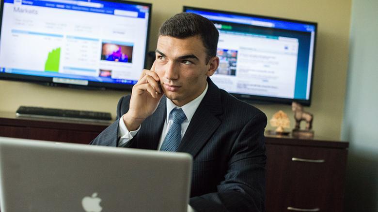 Nick Miller at a desk