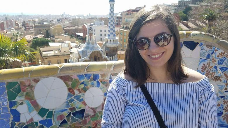Student posed on a bench in Park Guell