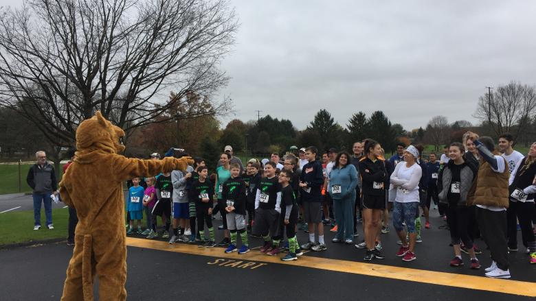 Nittany Lion pumps up crowd of runners