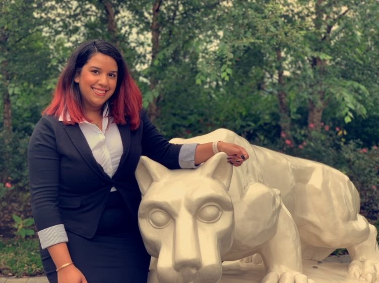 head shot of student: Fatima Alba with Nittany Lion