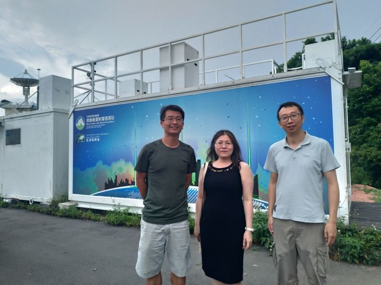 three people in front of a facility